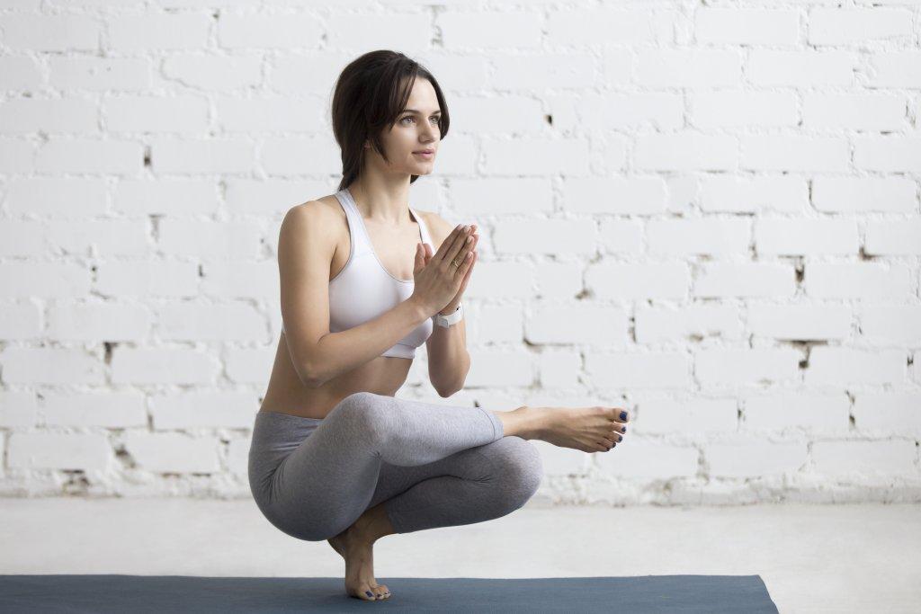 Yoga-Hockstellung